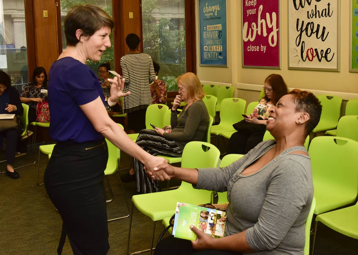 A Weight Watchers coach introduces herself to a client.