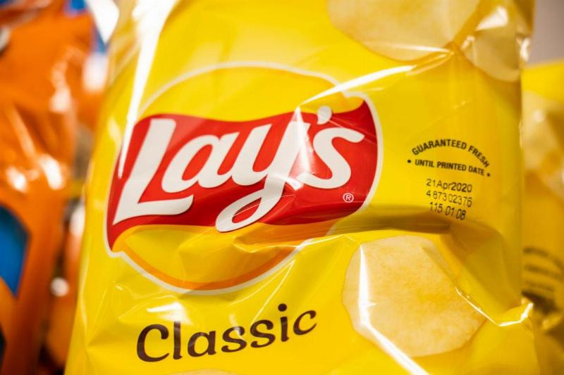 Lay's potato chips pack on a grocery store shelf