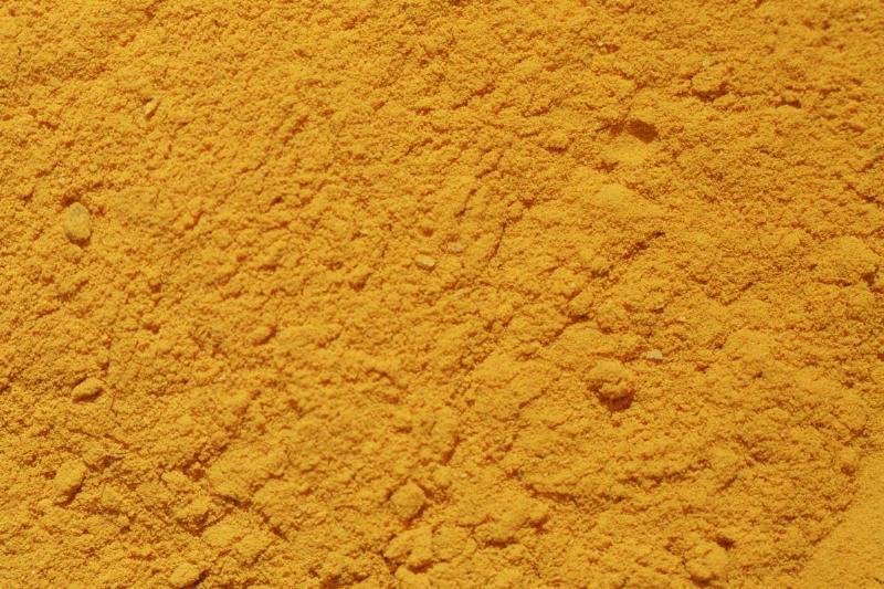 A close-up shows dried turmeric powder.