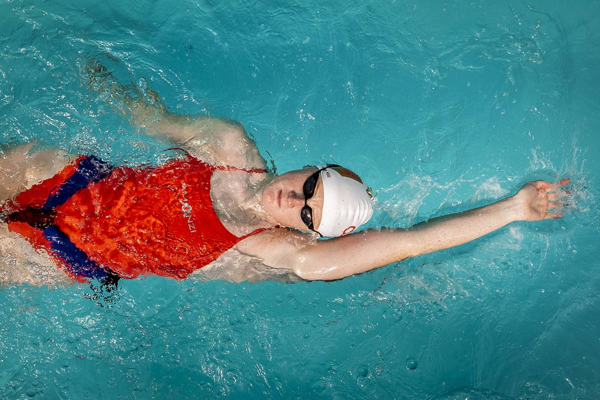 International swimmer Danielle Hill Irish practices in a pool.