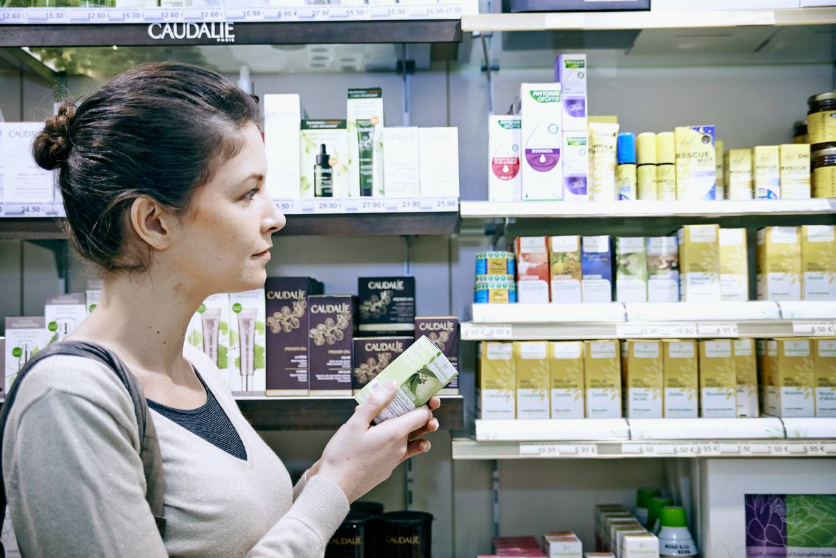 A woman buys essential oils at a non-prescription drug store.