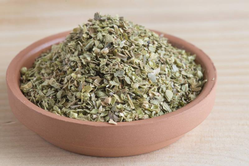 Dried oregano is in a bowl.