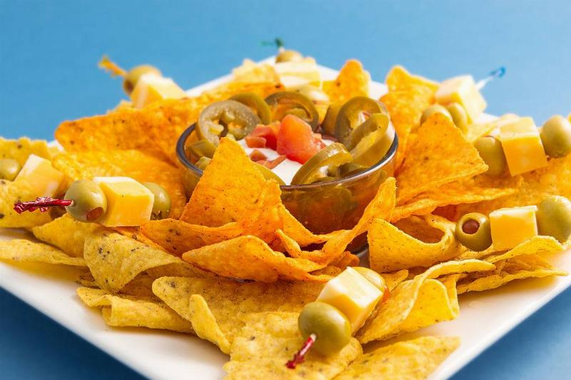 Spicy mexican nachos over a blue background