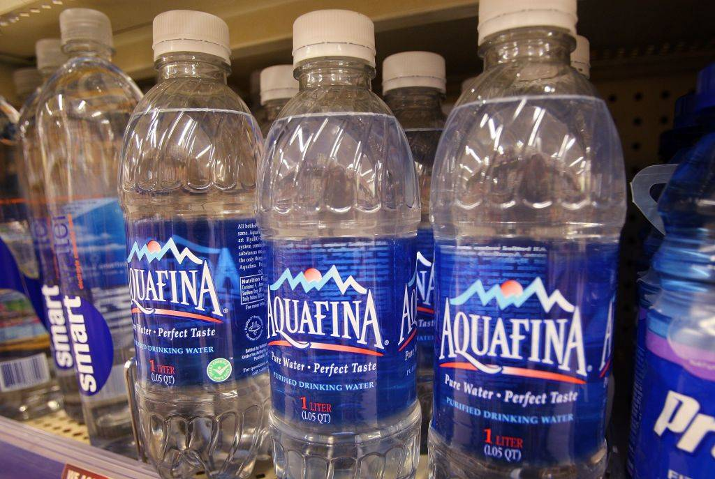 bottles of Aquafina watter on a shelf