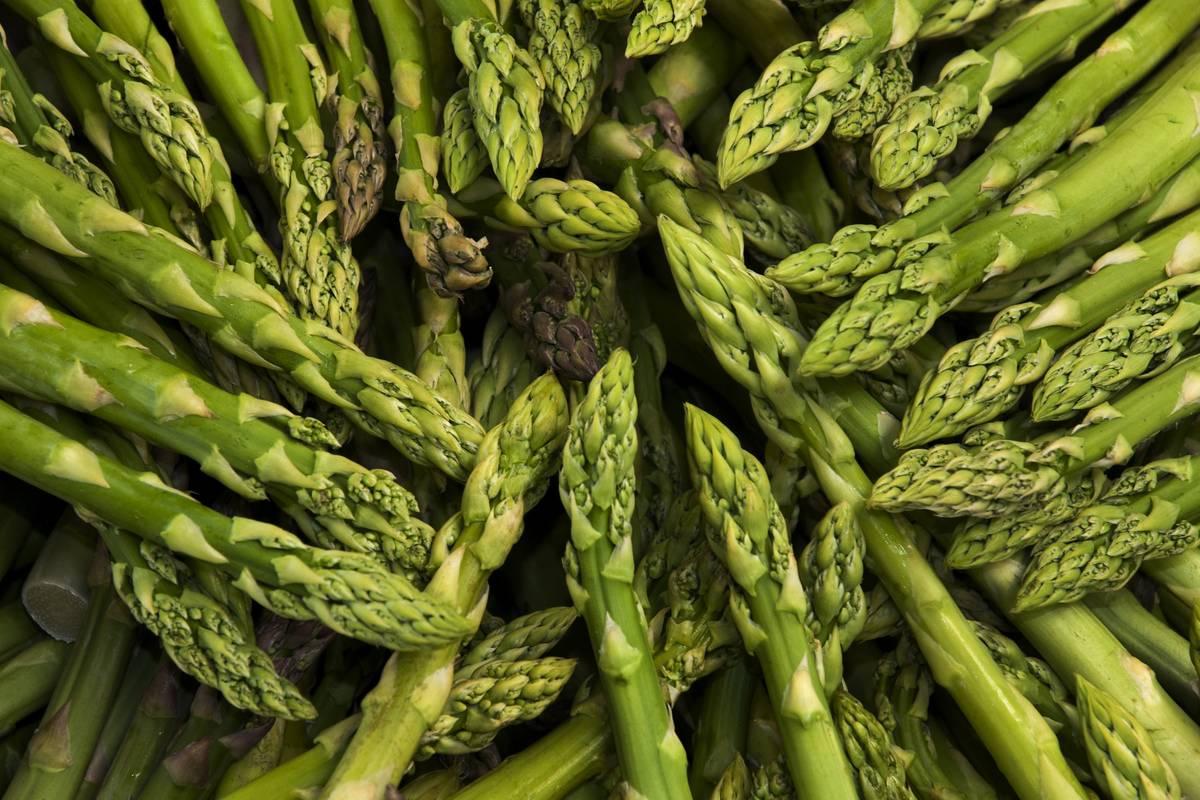 Asparagus lies in a circular pile.