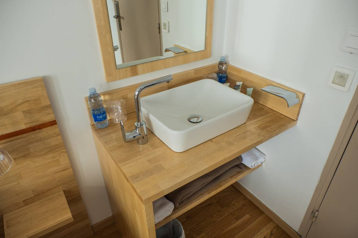 A square bathroom sink is pictured.
