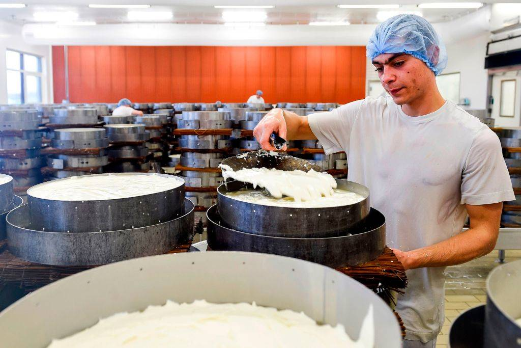 An employee controls the coagulation on February 16, 2020, at the Donge Brie de Meaux cheese factory