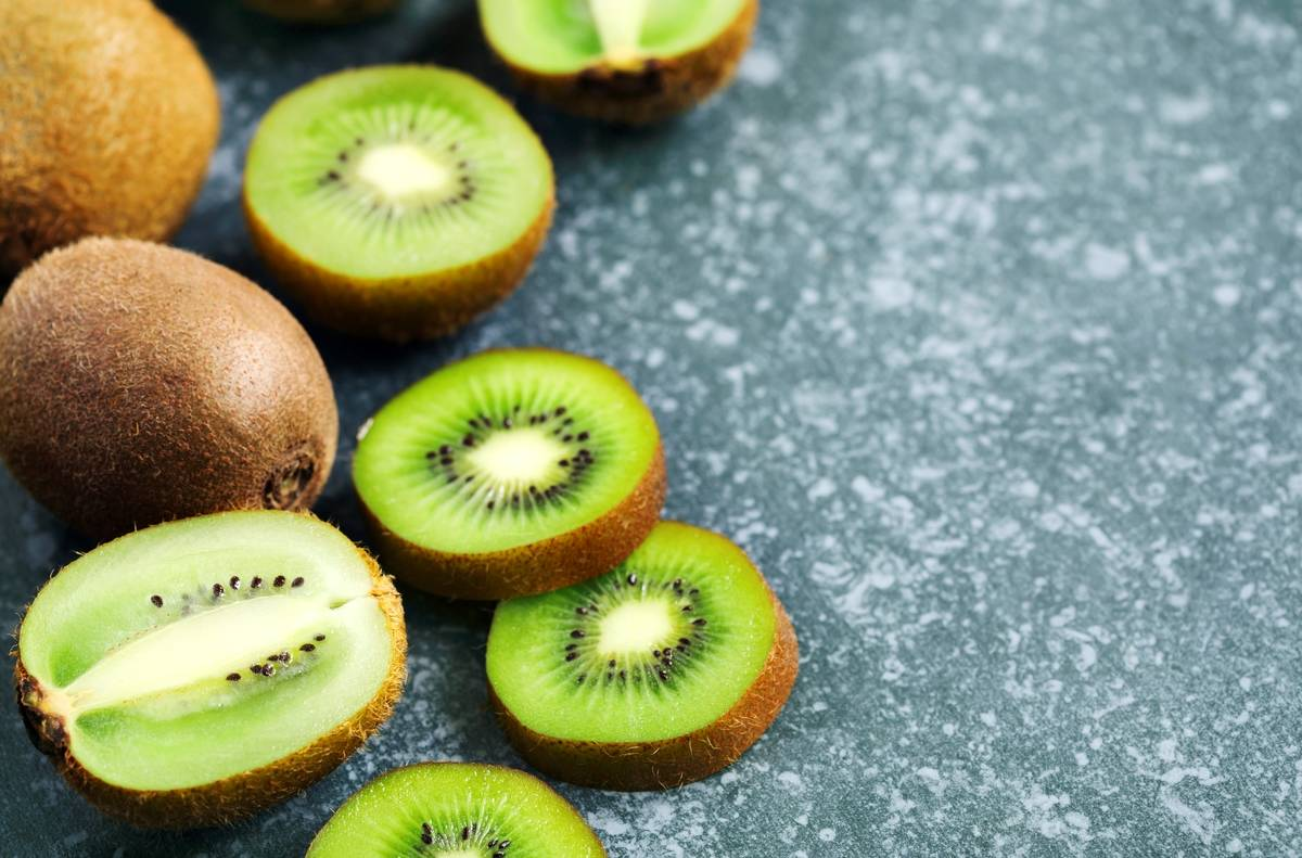 Kiwi fruits on stone background with copy space