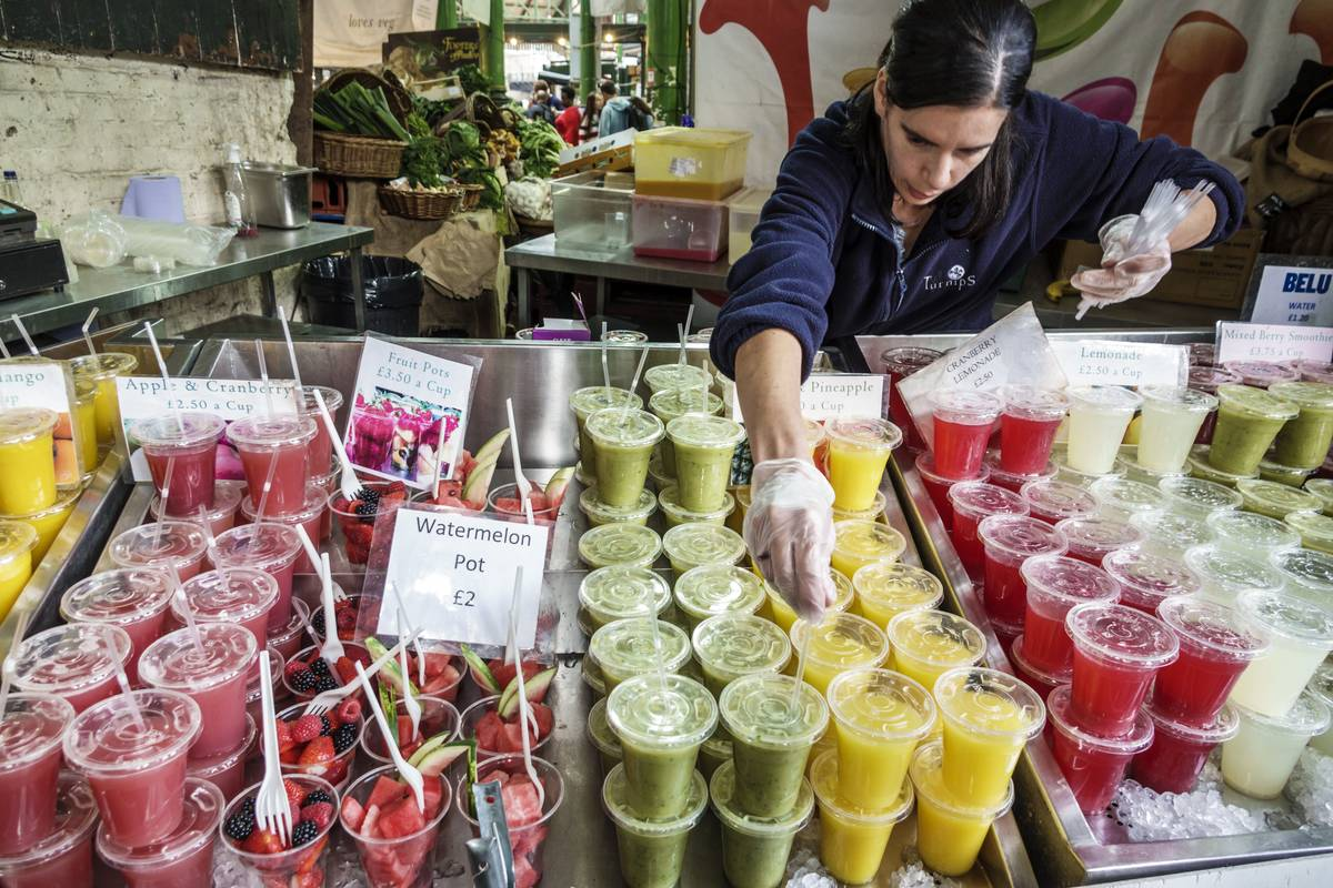 A vendor in London sells fresh juice.