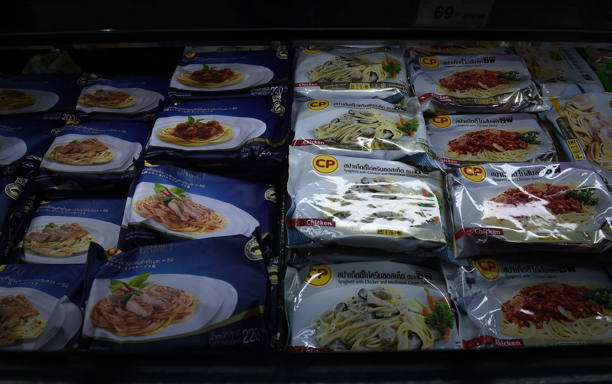 Frozen meals are displayed in a supermarket in Thailand.