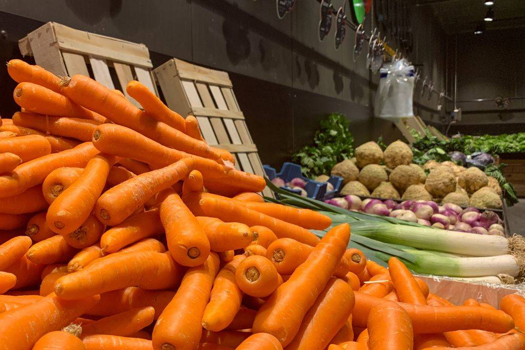 carrots on display at a grocery store