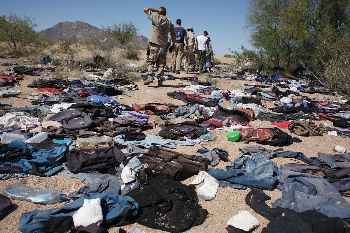 Clothes lie on the ground in the Sonoran desert.
