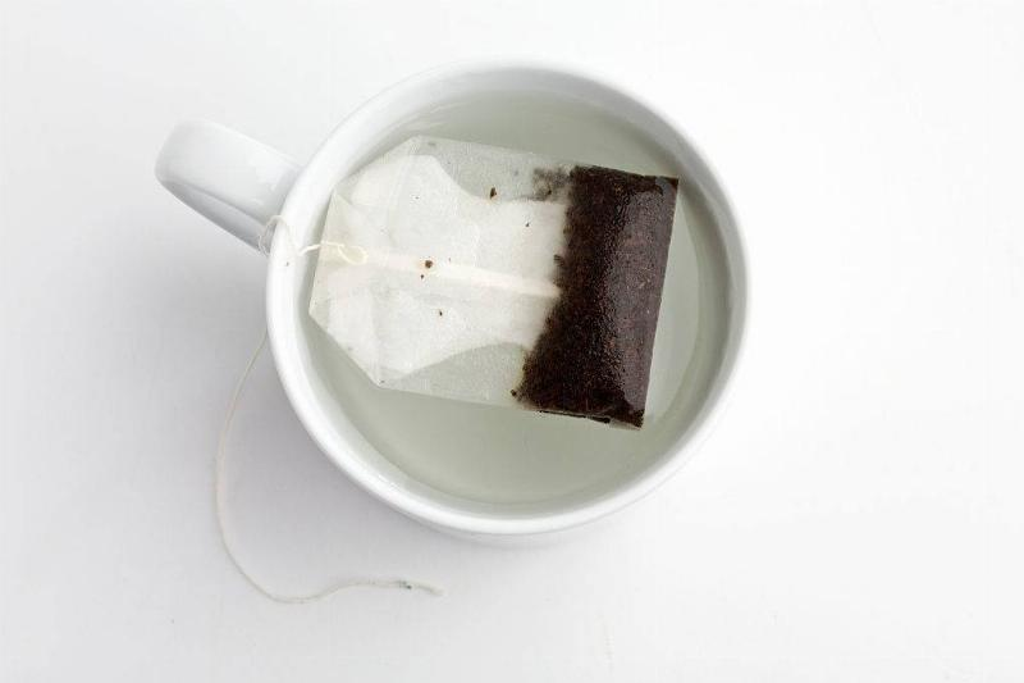 a tea bag inside a mug of water