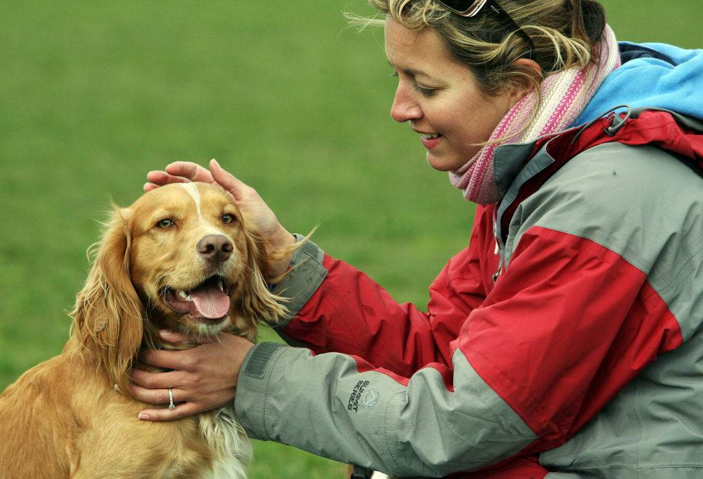a woman petting her dog