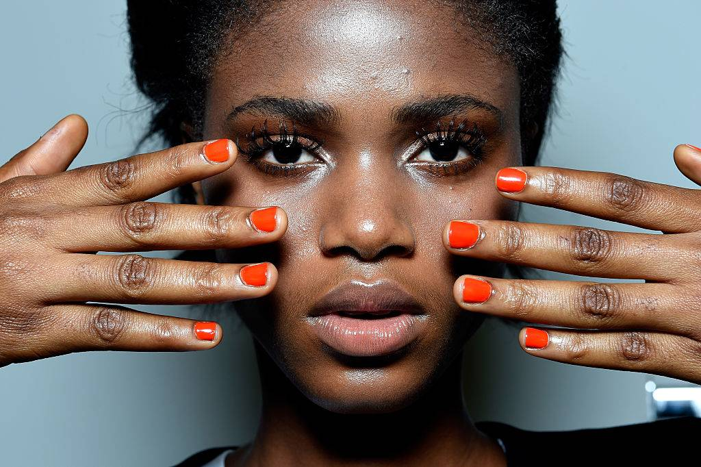 A woman with red nail polish