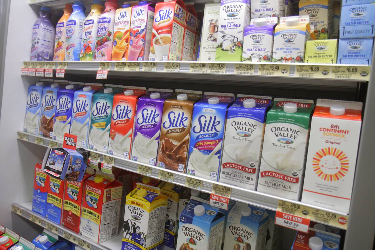 A grocery shelf offers soy milk.