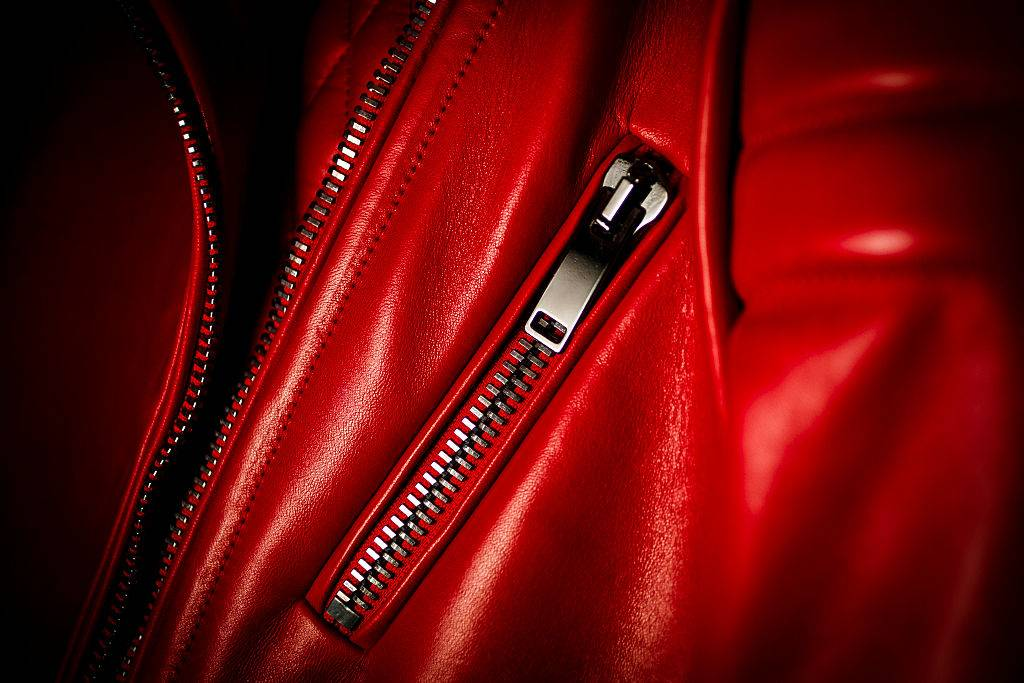 a red leather clothing item with a zipper