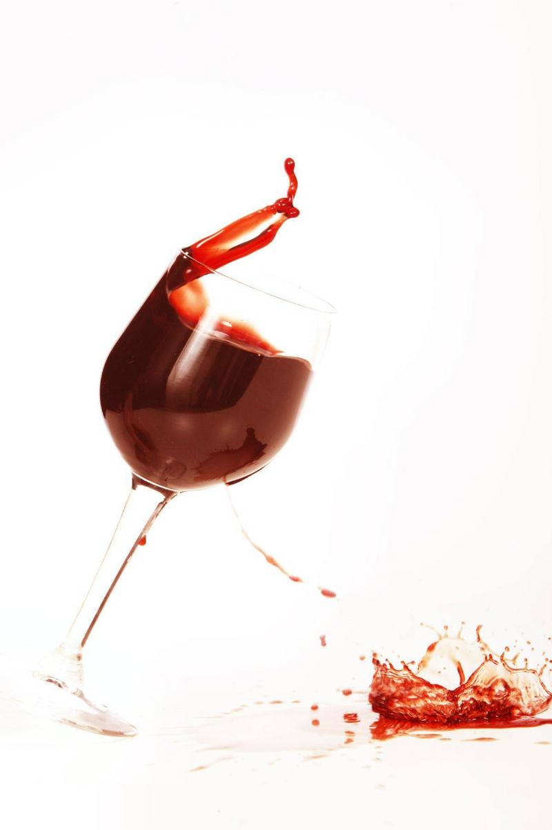 A glass of red wine spilling onto a table, 21 January 2004. AFR Picture by LOUI