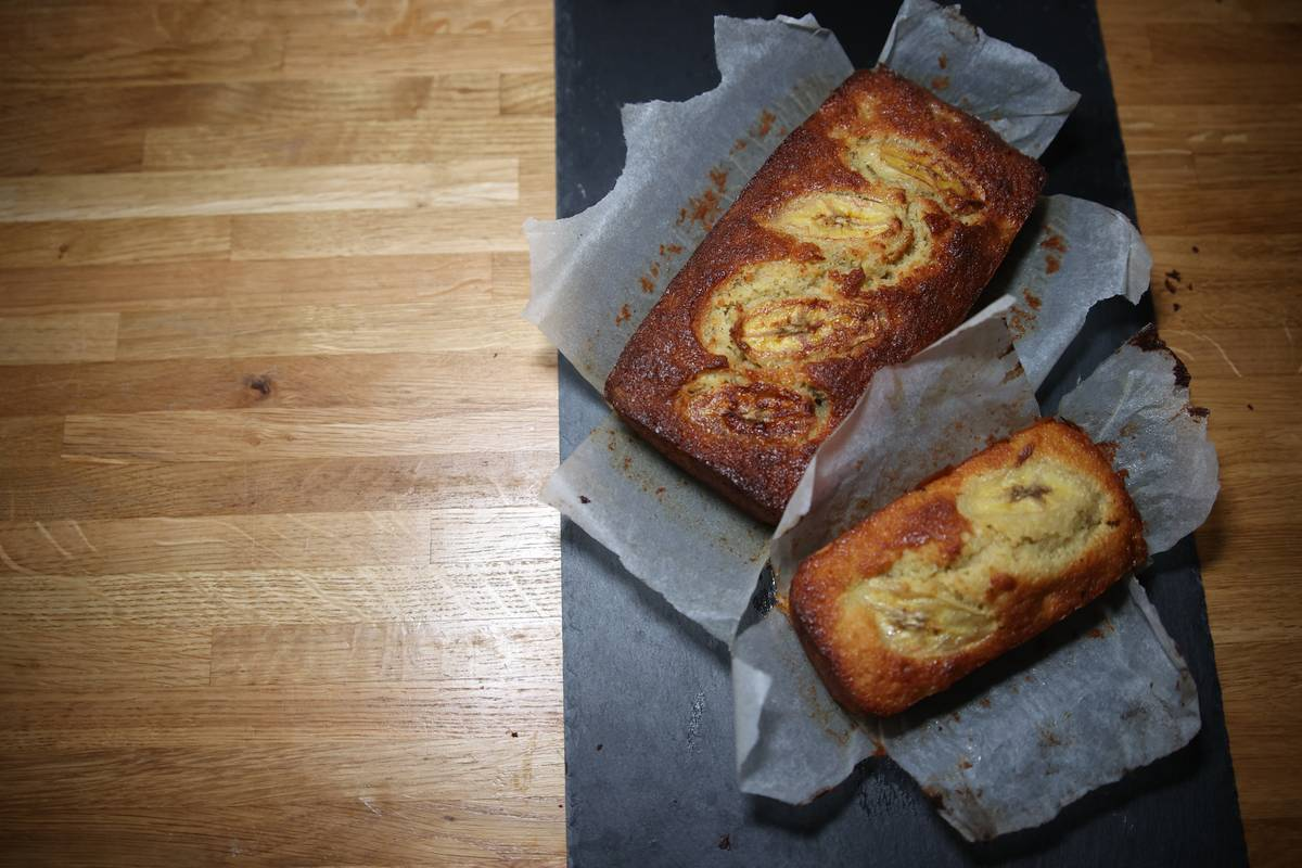Homemade banana bread sits on a table.