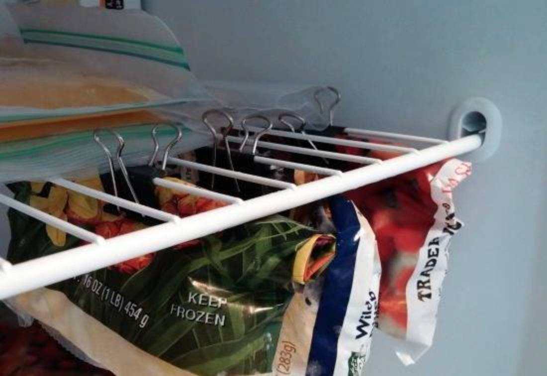 Food bags hang from binder clips.