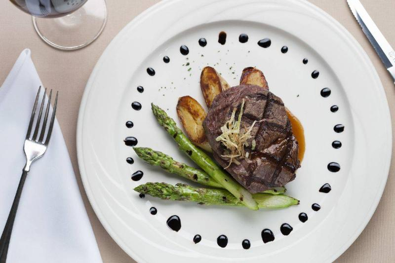 Overhead shot of filet mignon with asparagus and potatoes