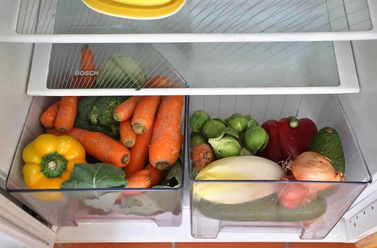 Raw vegetables are kept in the fridge's crisper drawers.
