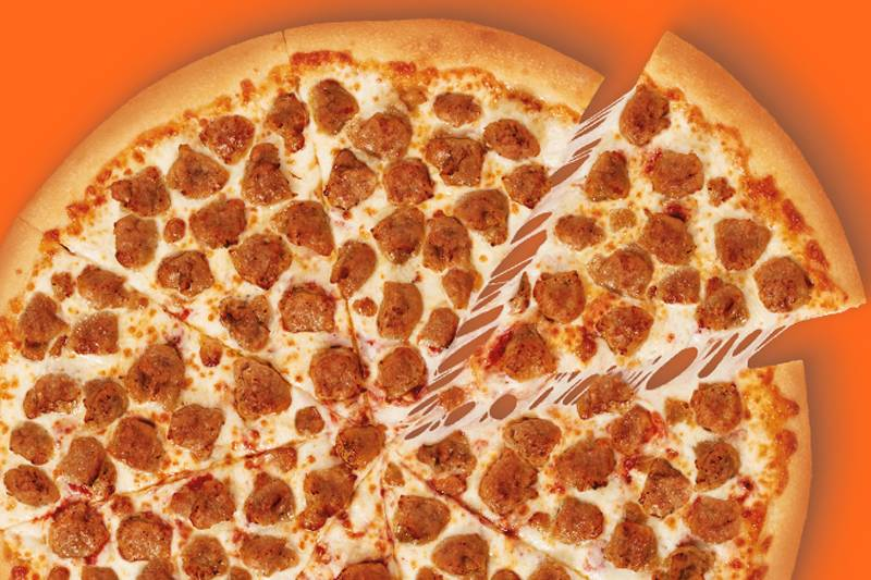Little Caesars Extramostbestest Italian Sausage Pizza against an orange background