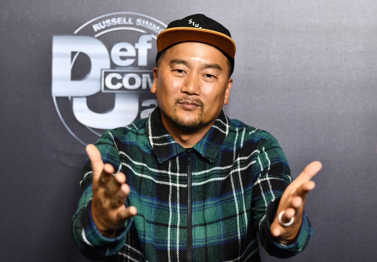 Roy Choi holds his hands out tot he camera during the Netflix presentation of