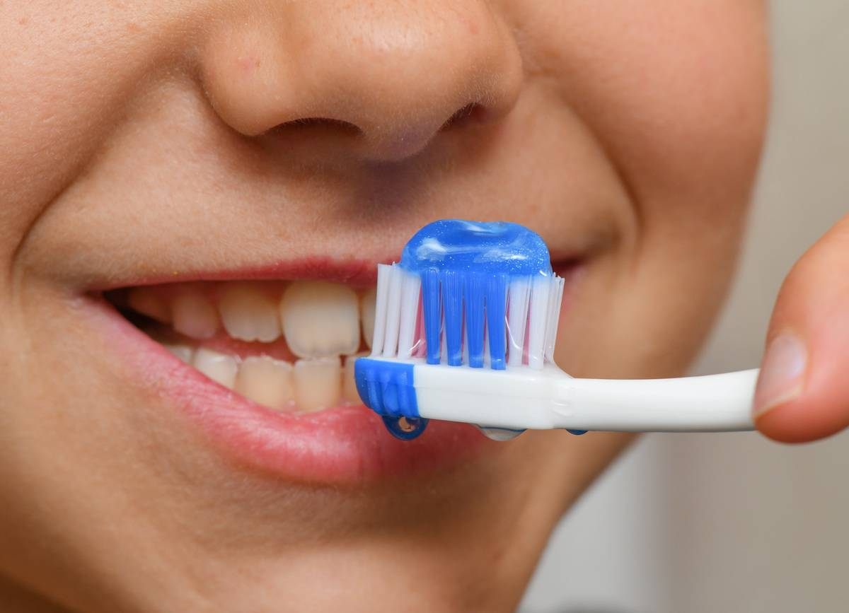 A close-up shows a boy brushing his teeth.