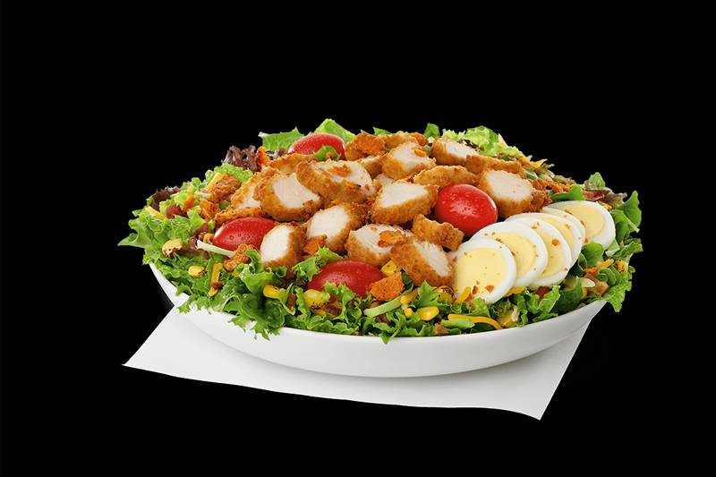 chick-fil-a cobb salad with chicken, tomatoes, eggs, and corn