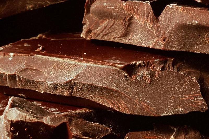 A close-up shows broken chocolate bars.