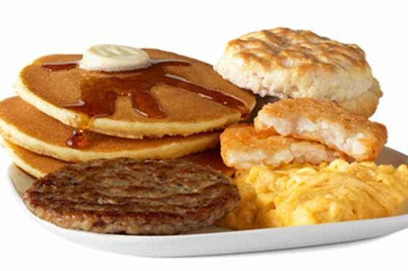 mcdonald's big breakfast with hotcakes including pancakes, sausage, biscuits, hash browns, and syrup