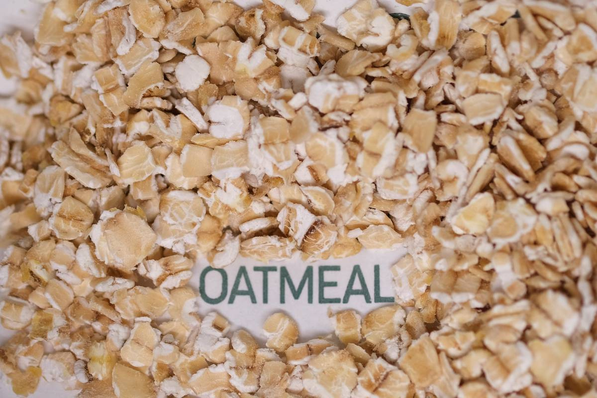 Dried oats surround a sign that says