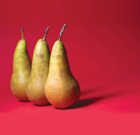 Three pears appear against a red background.