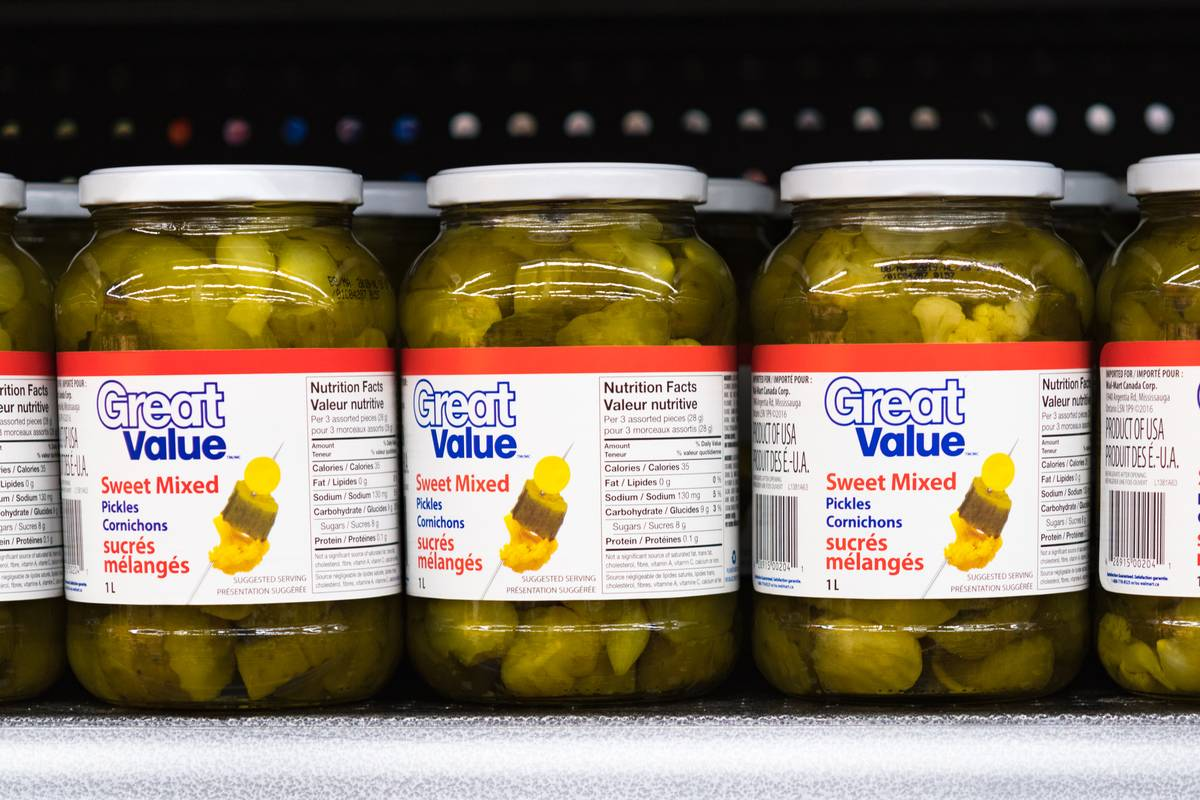 Pickle jars sit on a shelf.