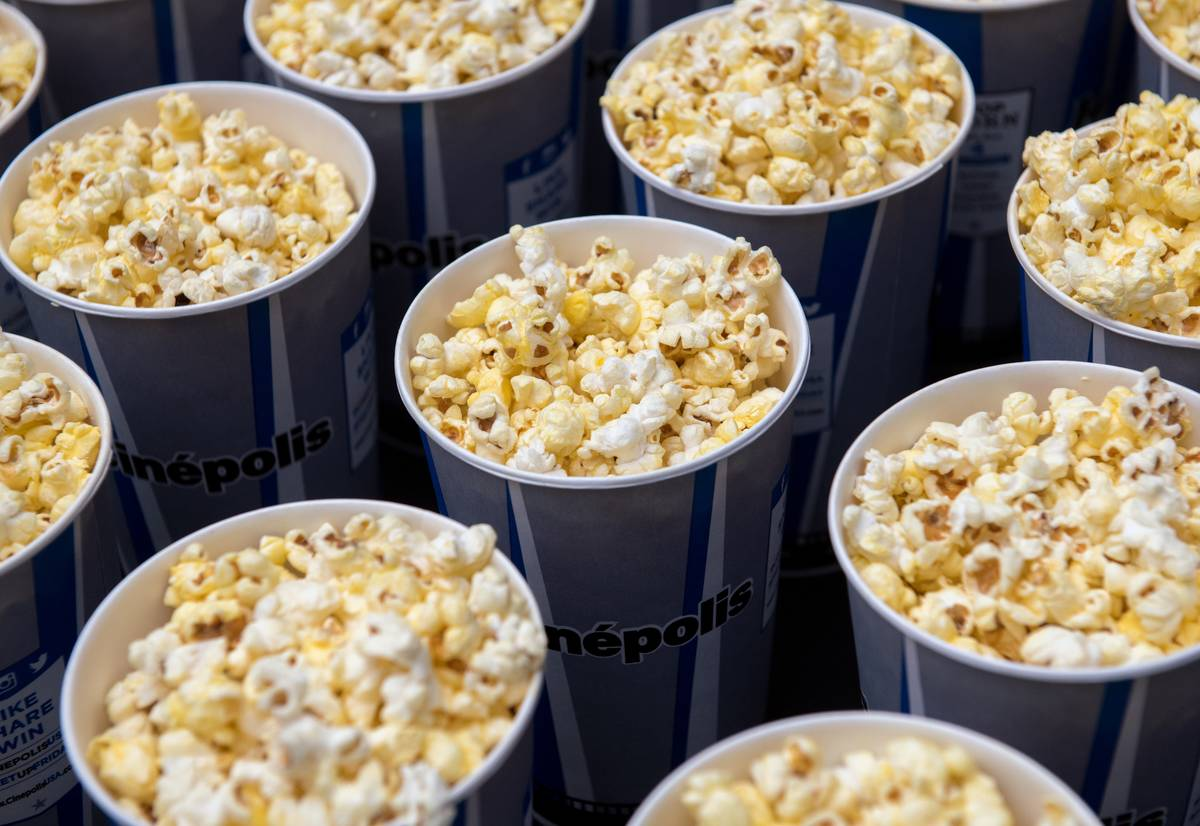 Various circular tubs of popcorn are seen.