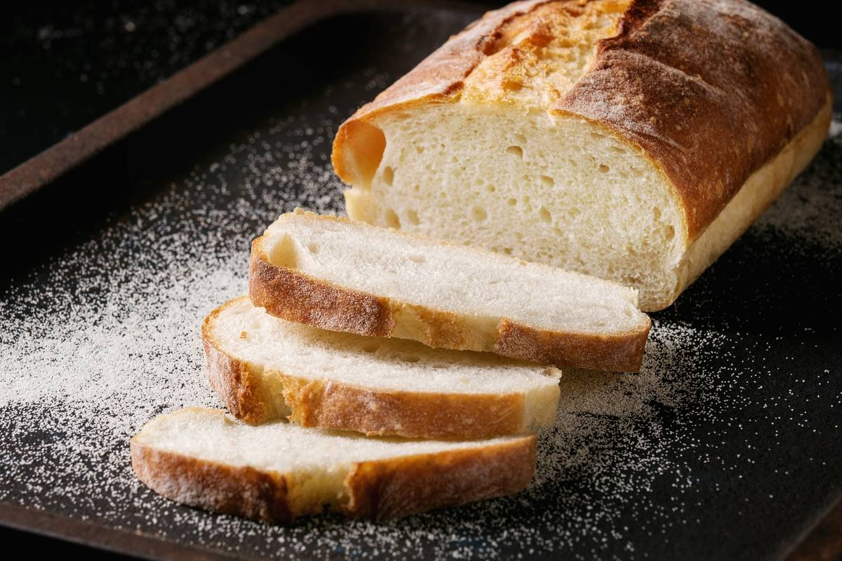 A loaf of bread is sliced.