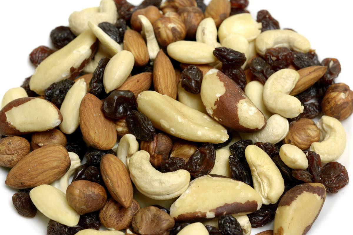 A close-up shows trail mix with cashews, almonds, and raisins.