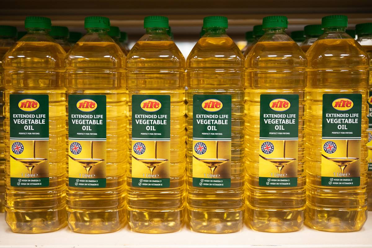 Bottles of vegetable oil stand in a row.