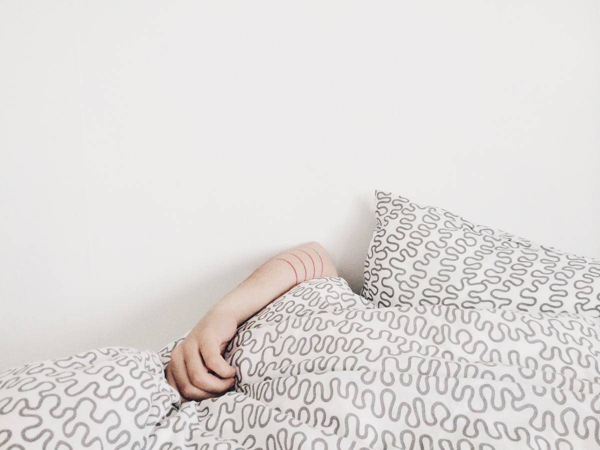 Picture of person under covers