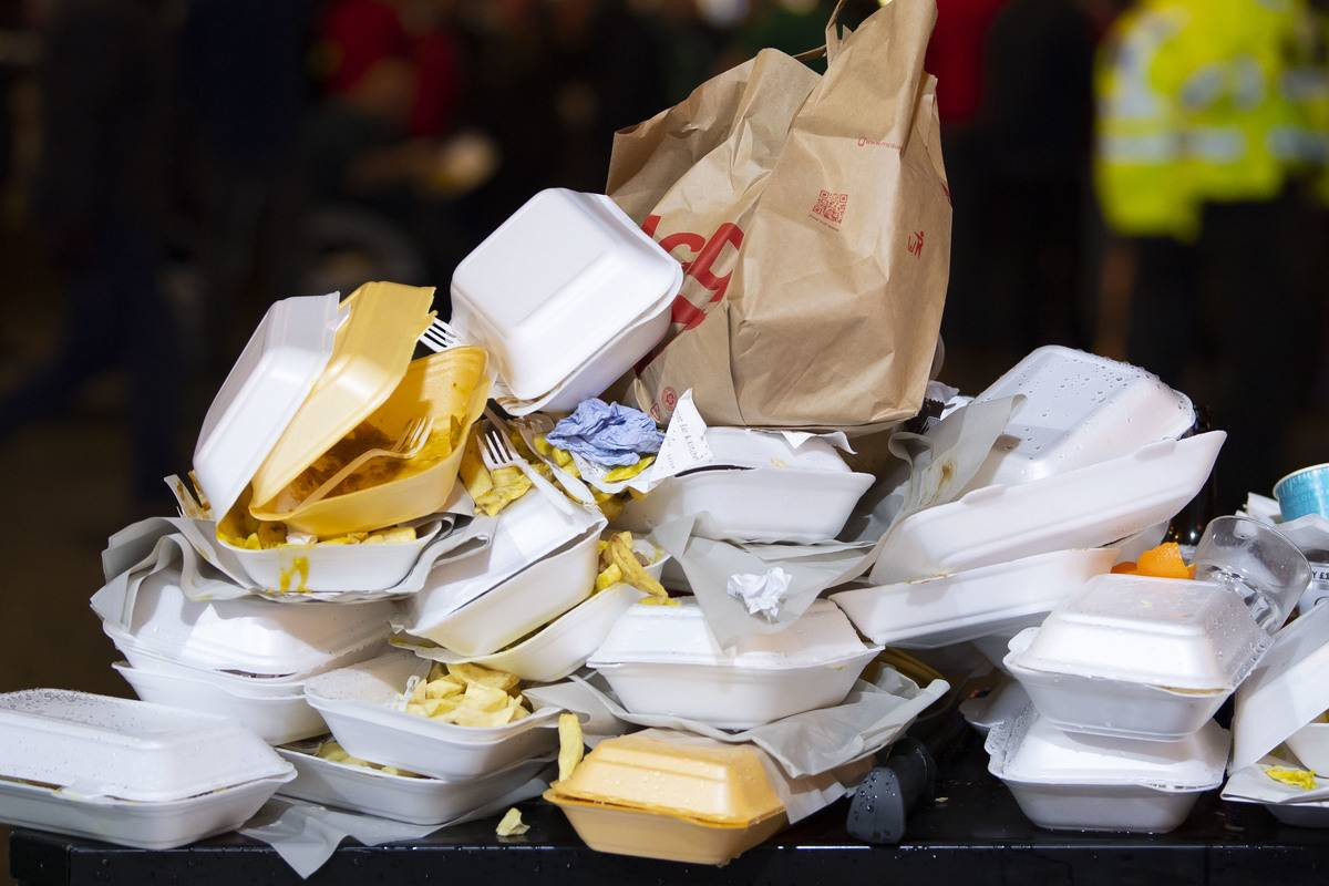 Multiple fast food containers are stacked on each other.