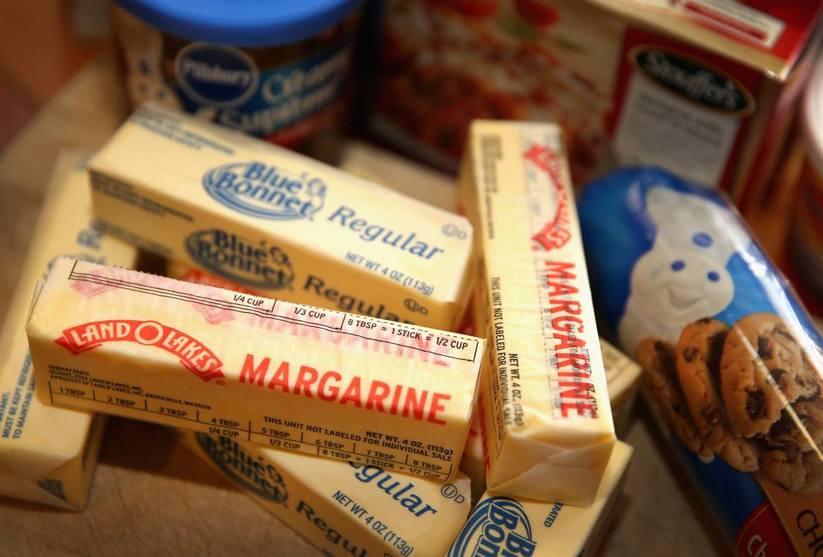 Sticks of margarine are layered on top of each other.