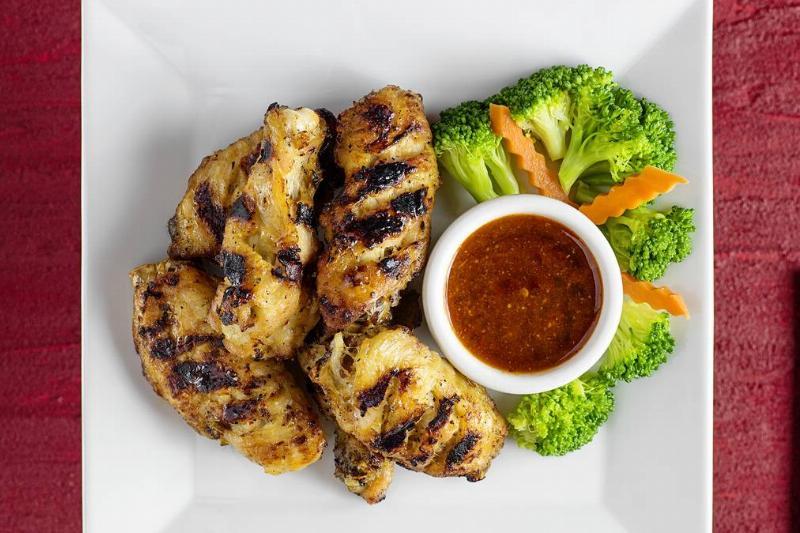 Peenk Peek Kai / Grilled Chicken Wings...