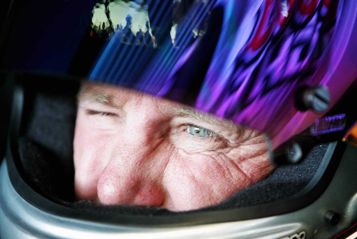 A NASCAR racer squints through his helmet.