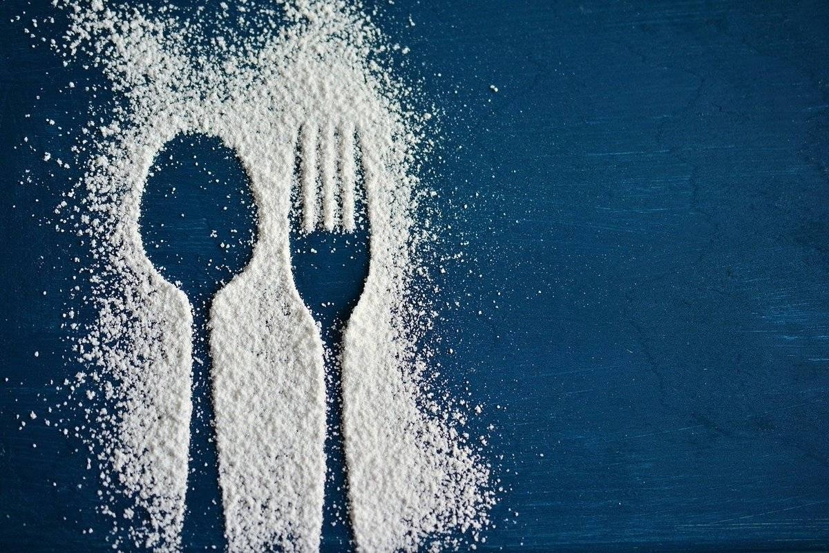 Powdered sugar is outlined in the shapes of a fork and spoon.