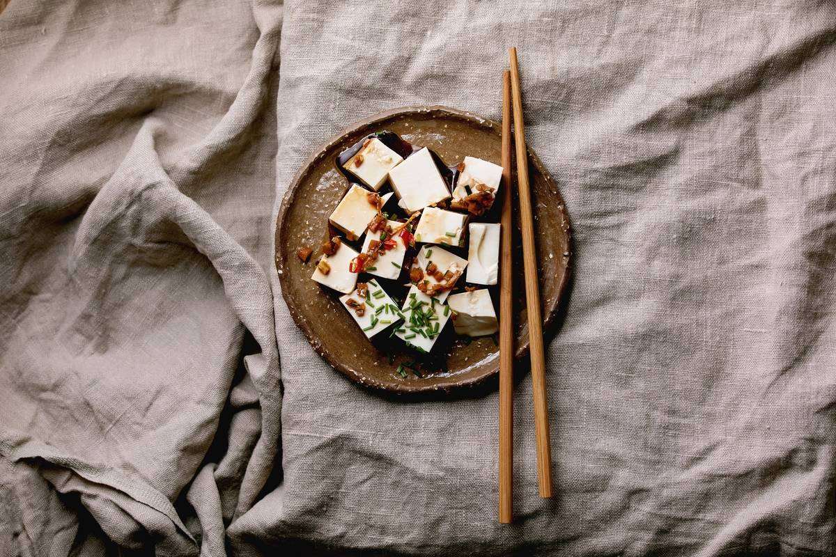 Cubes of flavored tofu are arranged on a plate.