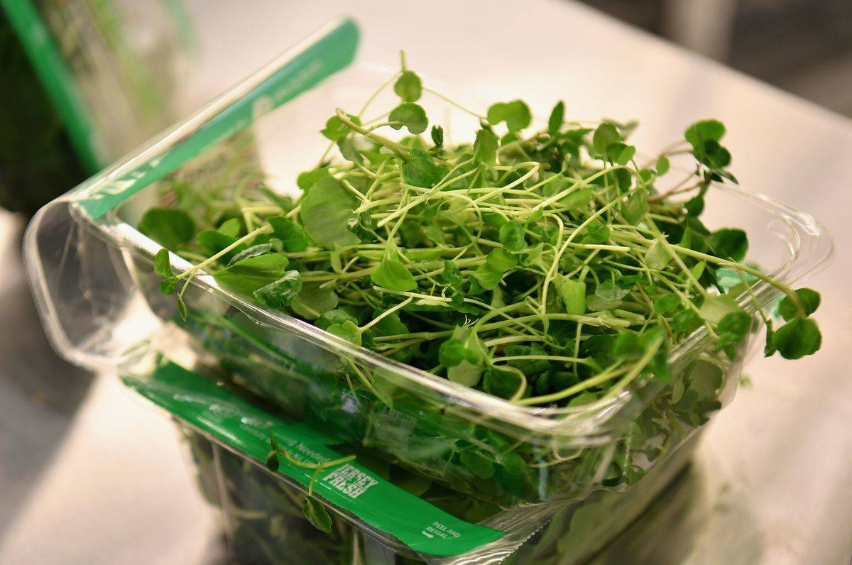 Baby watercress is in a plastic package.