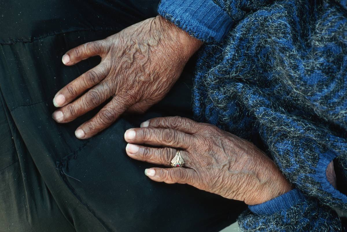 A photo shows an elderly person's hands.