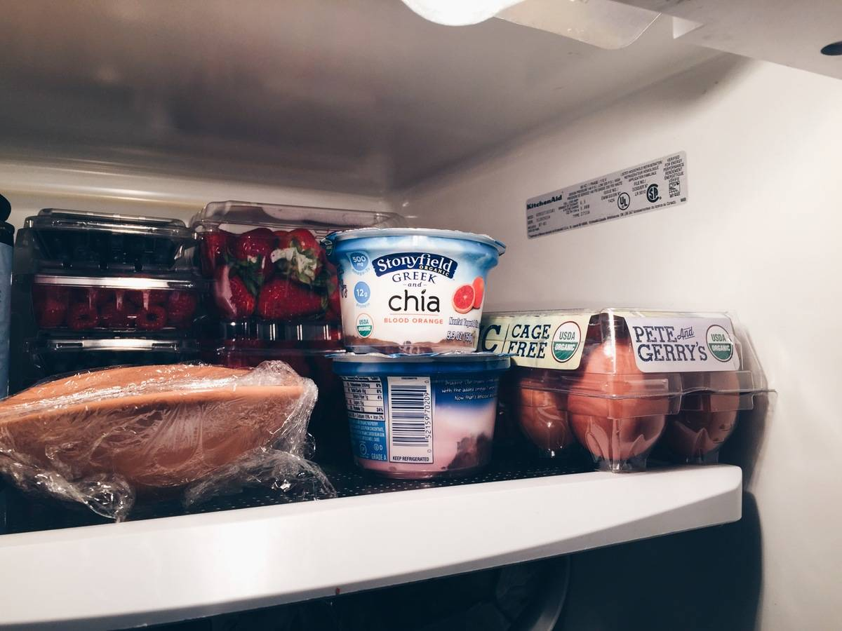 Packaged fruit-flavored yogurt is seen in a refrigerator.