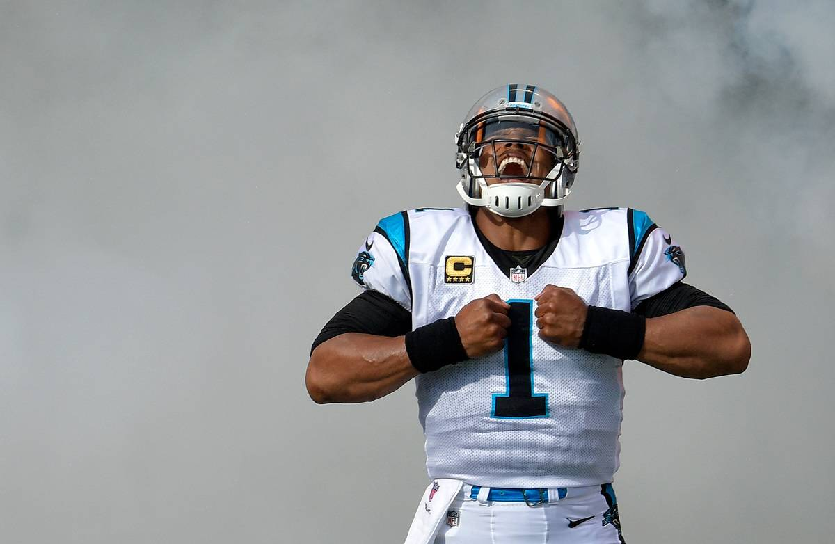 Cam Newton yells as he takes the field for a game against the Dallas Cowboys, 2018.